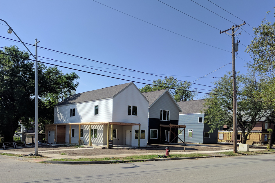 View of three houses under construction on the corner of 45th and Tracy Avenue.
